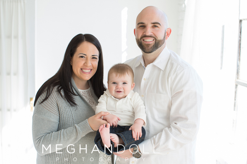 parents-snuggle-their-six-month-old-son