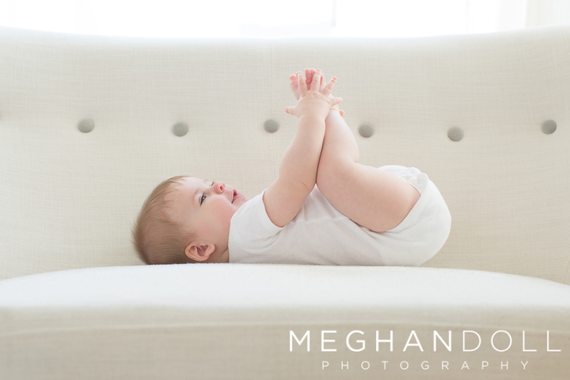 six-month-old-boy-plays-with-his-toes