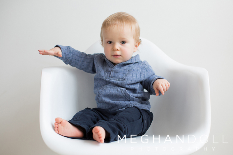 one-year-old-boy-in-chair-wearing-blue