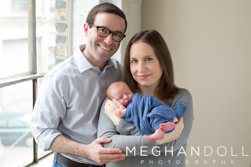 mom-and-dad-hold-newborn-son