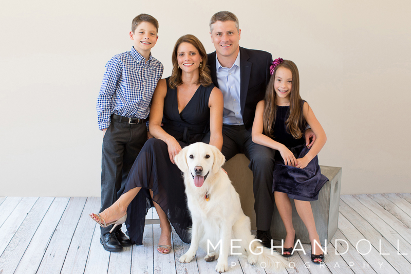 nice-family-of-four-poses-with-their-dog