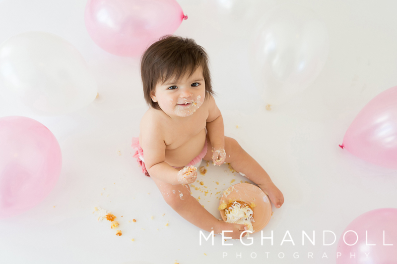 one-year-old-girl-with-cupcake