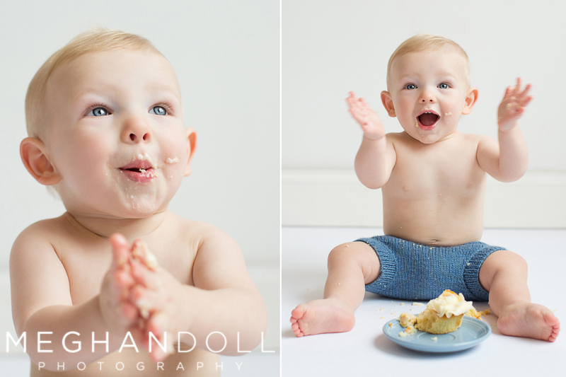 one-year-old-boy-with-cupcake-laughs-and-claps