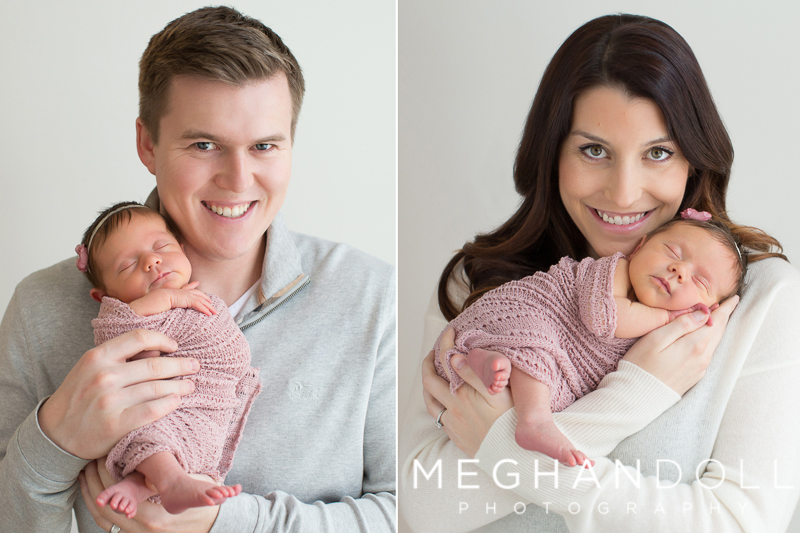 new-mom-and-dad-hold-newborn-girl