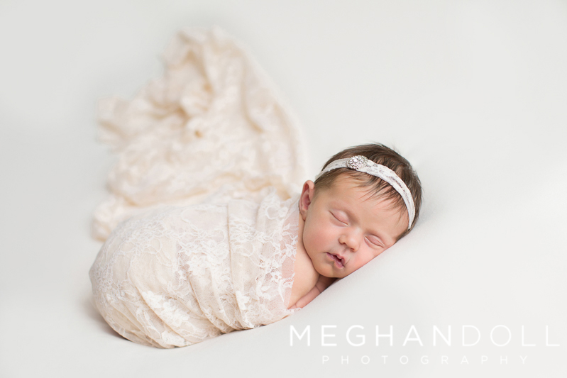 newborn-girl-on-white-in-lace