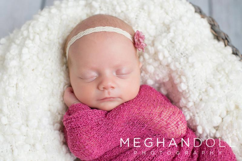 twin-newborn-girl-in-dark-pink