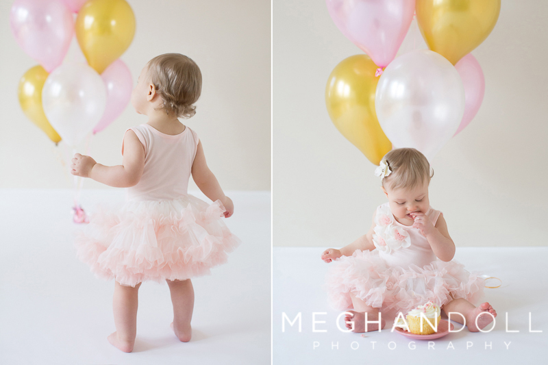 one-year-old-girl-plays-with-balloons-and-cupcake
