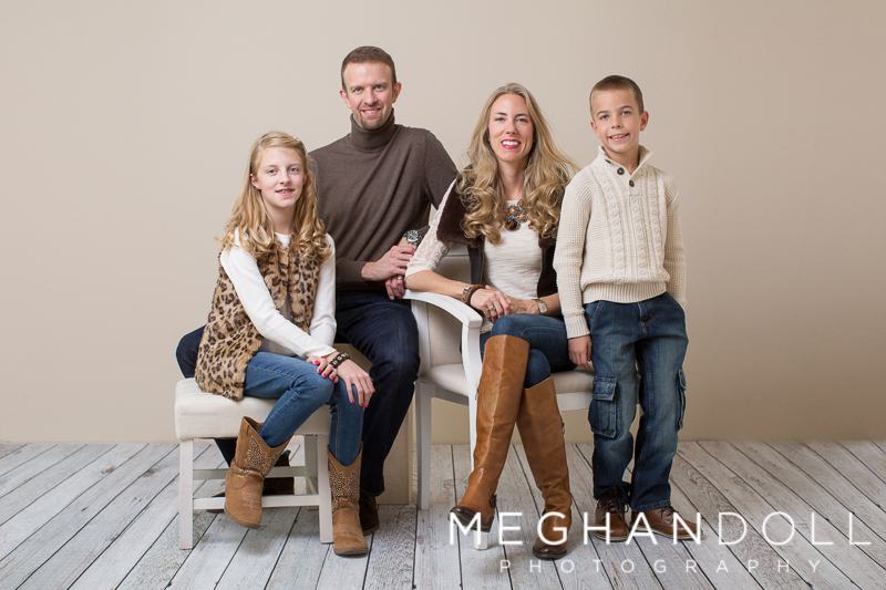 family-of-four-smile-in-brown