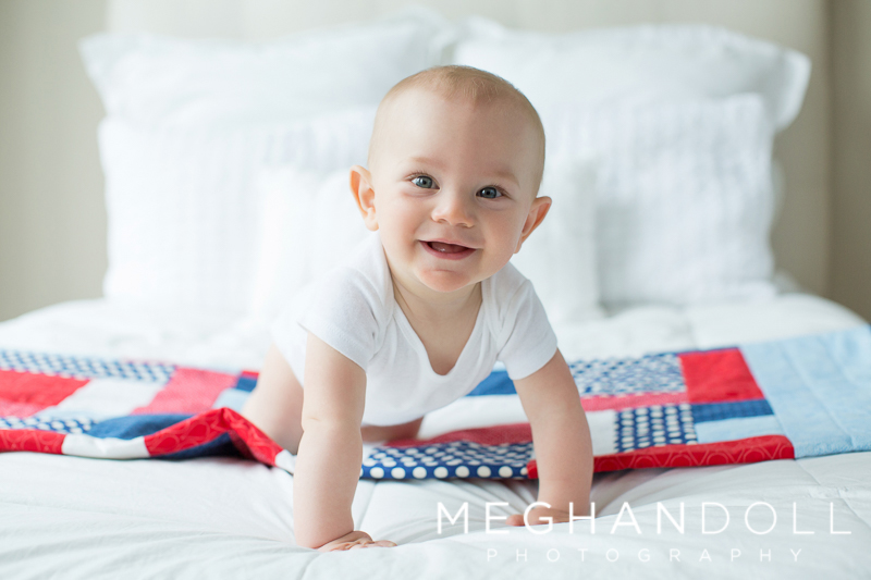 six-month-old-boy-plays-on-quilt