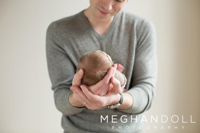 Father-holding-newborn-baby