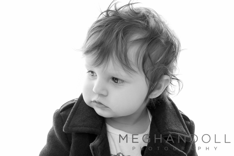 one-year-old-baby-girl-close-up-in-peacoat