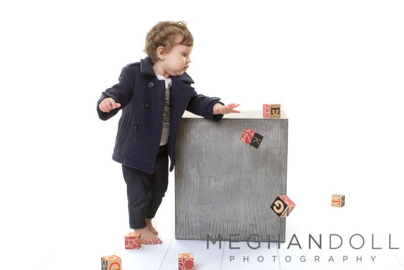 one-year-old-in-peacoat-throws-blocks