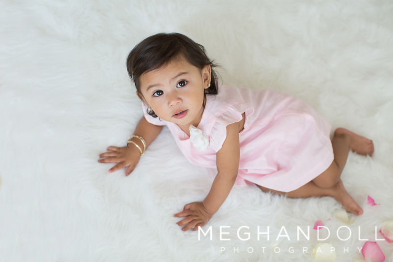 toddler-in-pink-plays-on-white-rug