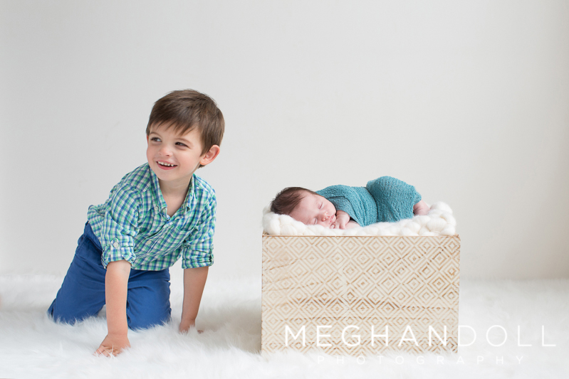 big-brother-laughs-with-his-new-baby-brother