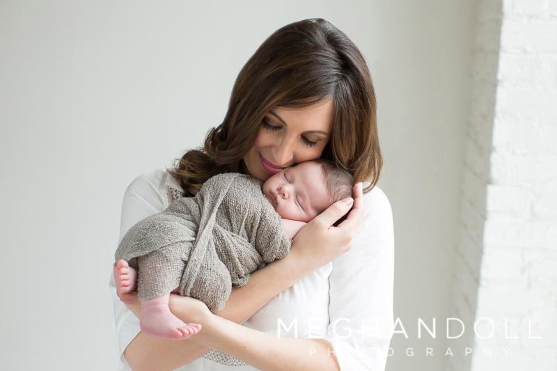 mom-snuggles-her-newborn-son