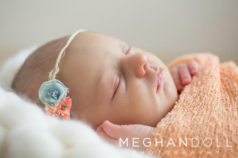 close-up-of-newborn-girl-in-orange