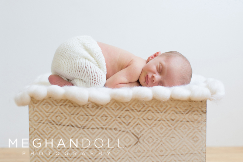baby-boy-laying-on-box-with-white-fluffy-blanket-2
