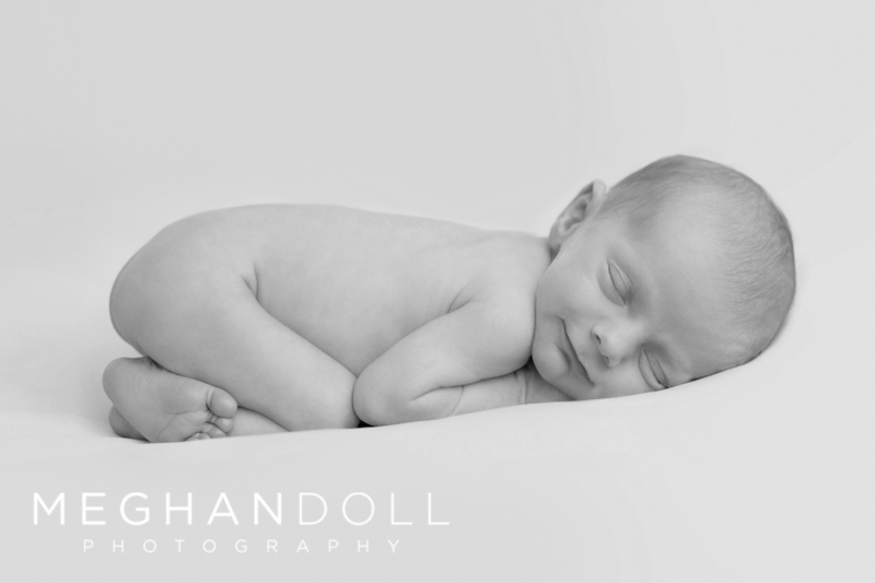 baby-boy-smiling-cuddeled-in-blanket-2