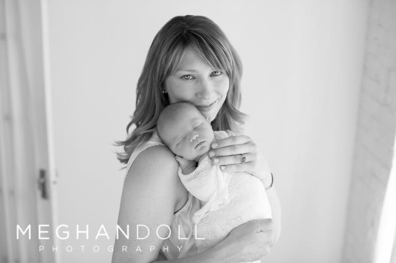 mom-snuggling-with-newborn-baby