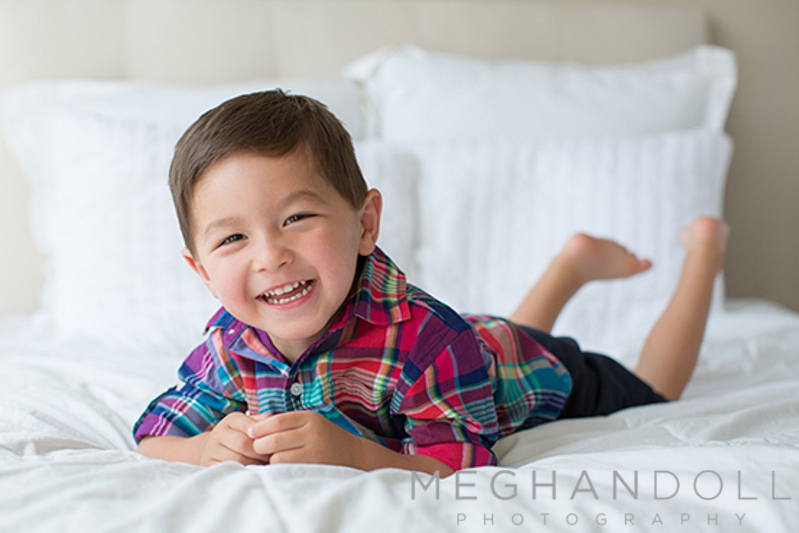 cute-boy-smiling-laying-on-bed