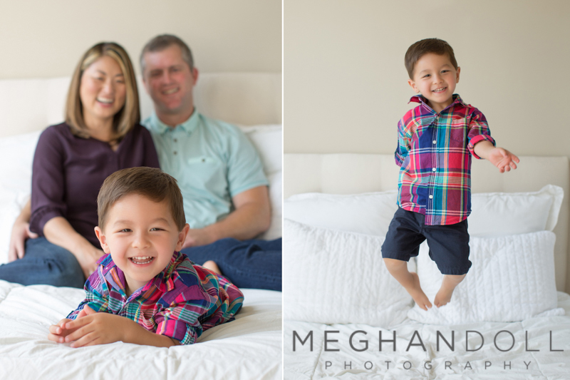 family-of-three-onbed-boy-jumping
