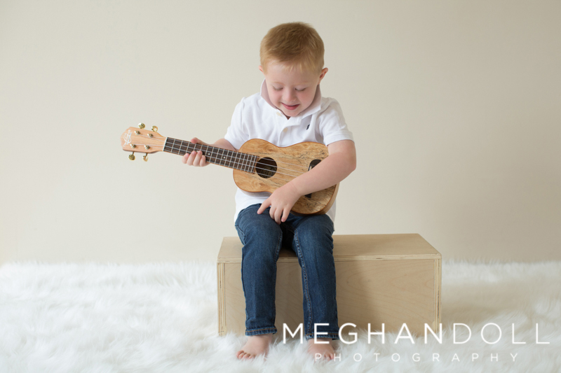 boy-playing-and-looking-down-at-guitar.jpg