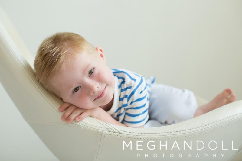 boy-sitting-on-edge-of-chair-smiling.jpg