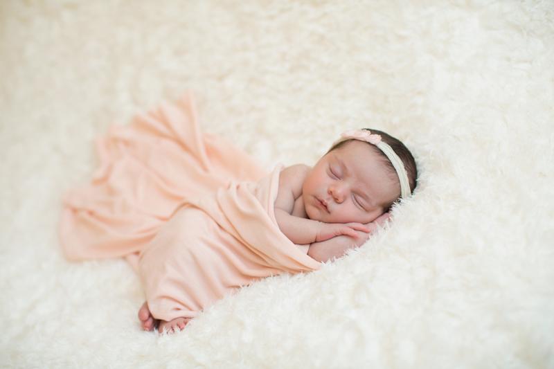 newborn-with-dark-hair-sleeping-on-blanket.jpg