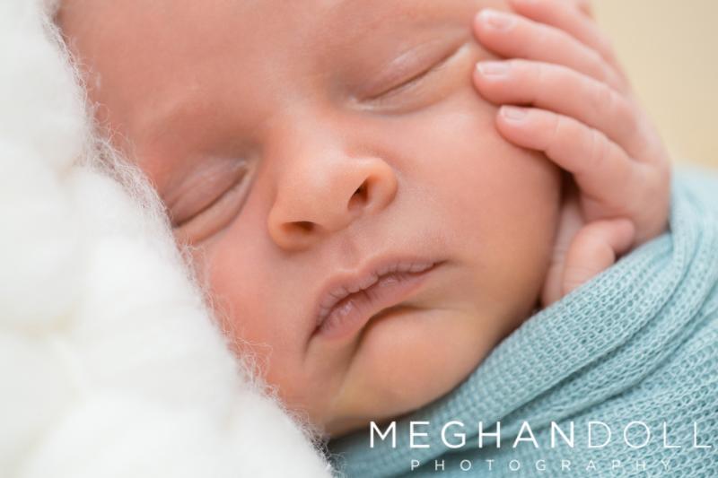 close-up-newborn-on-face.jpg