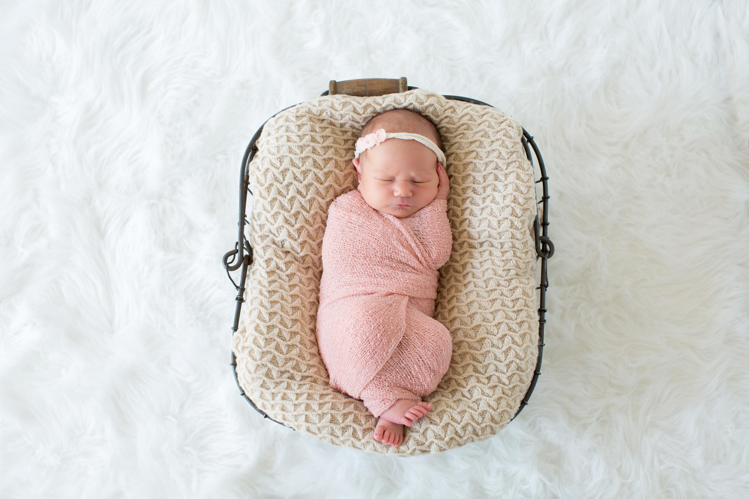 baby-girl-swaddled-in-pink.jpg