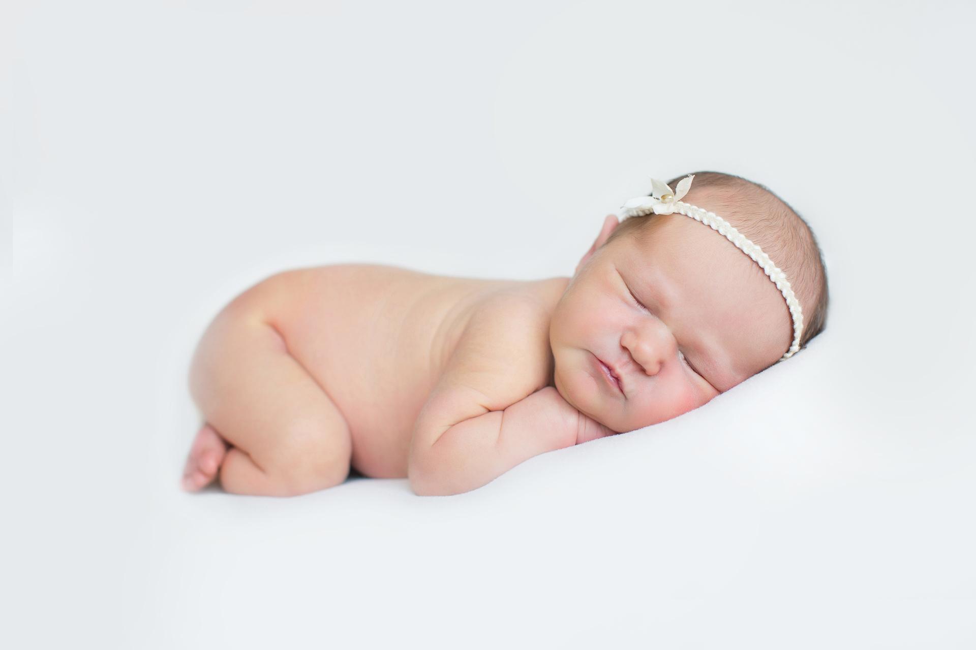 newborn-sleeping-with-cute-headband-1.jpg