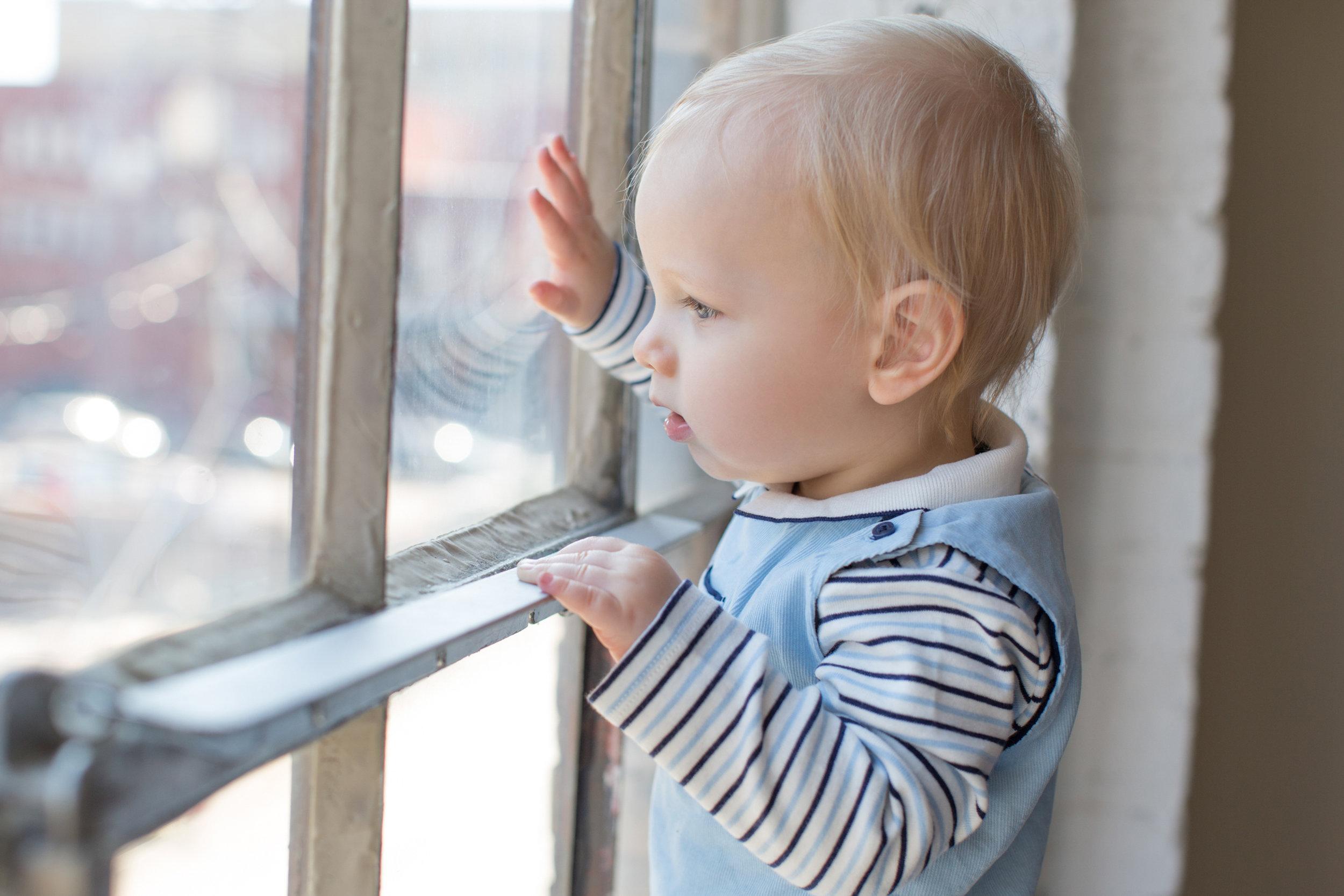 little_boy_looking_out_the_window.jpg