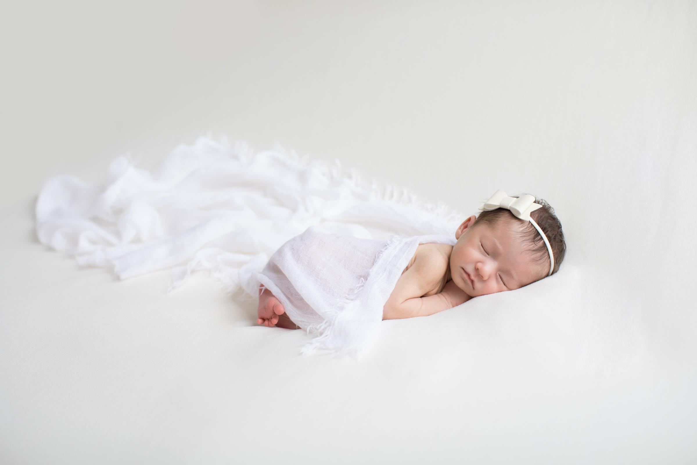 newborn_wrapped_In_white.jpg