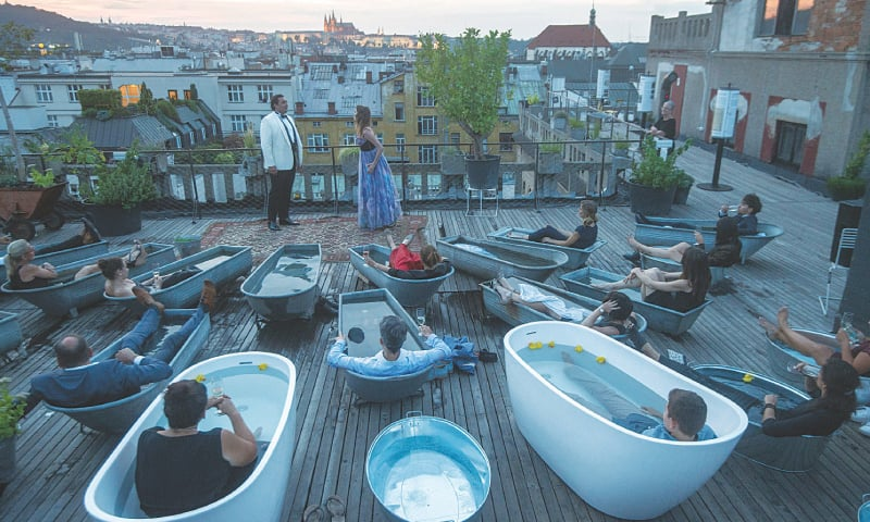 Listening to opera from a rooftop bathtub: Czech!