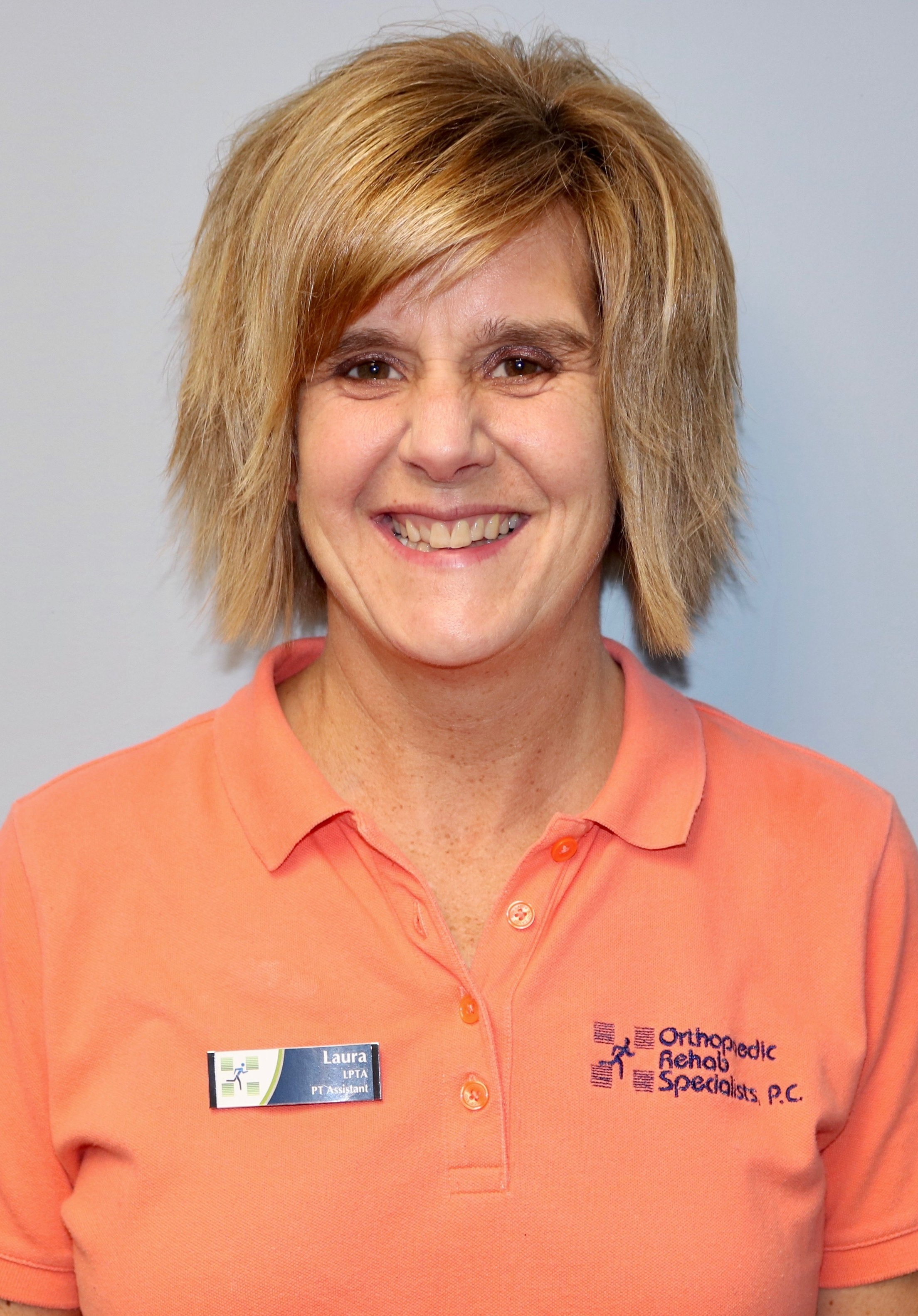 Laura Hause - PTA  East Clinic  Laura started at ORS in 1988 as a Therapy Aide. She received her Associate's Degree in Applied Science from Kellogg Community College in 1993. Laura has worked in various settings, including neuro rehab, home care, skilled nursing, and out-patient clinics. She enjoys working with many different diagnoses, but especially with total knee replacements, total hip replacements, and shoulder injuries and is trained in the Graston Technique®. When not working, Laura enjoys spending time with her husband and two daughters, who are very active in sports. She also enjoys outdoor activities, running, and swimming.