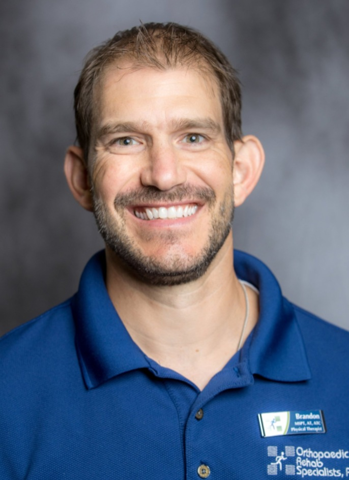 Brandon Klump MSPT, AT, ATC Vice President of Finance  Clinic Director Foot, Ankle & Running Center of Jackson  Brandon is a co-owner and Physical Therapist. He has been with ORS since 2003 and is a graduate of Alma College with a Bachelor's Degree of Science in Exercise and Health Science. He then completed his Master's Degree in Physical Therapy at Washington University in St. Louis. Brandon's clinical interests include orthopedics and sports medicine, and performance training. He is married to his wife, Emily and they have four boys named Brogan, Lucas, Graham, and Andrew. Brandon enjoys running, soccer, golf, and is active in his church.