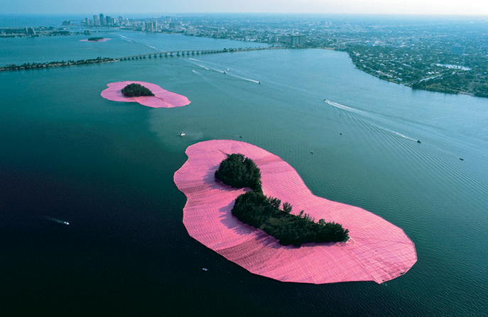 aclockworkorange :      Christo and Jeanne-Claude ,  Surrounded Islands , 1980-1983     Christo and Jeanne-Claude created this environmental artwork by surrounding 11 small islands with 6.5 million square feet of pink fabric. The work existed for only two weeks.       So part of me always wants to be like, oh, Christo is a tool, but fuck, sometimes the scale, simplicity, and ephemerality of his work makes me want to cry.
