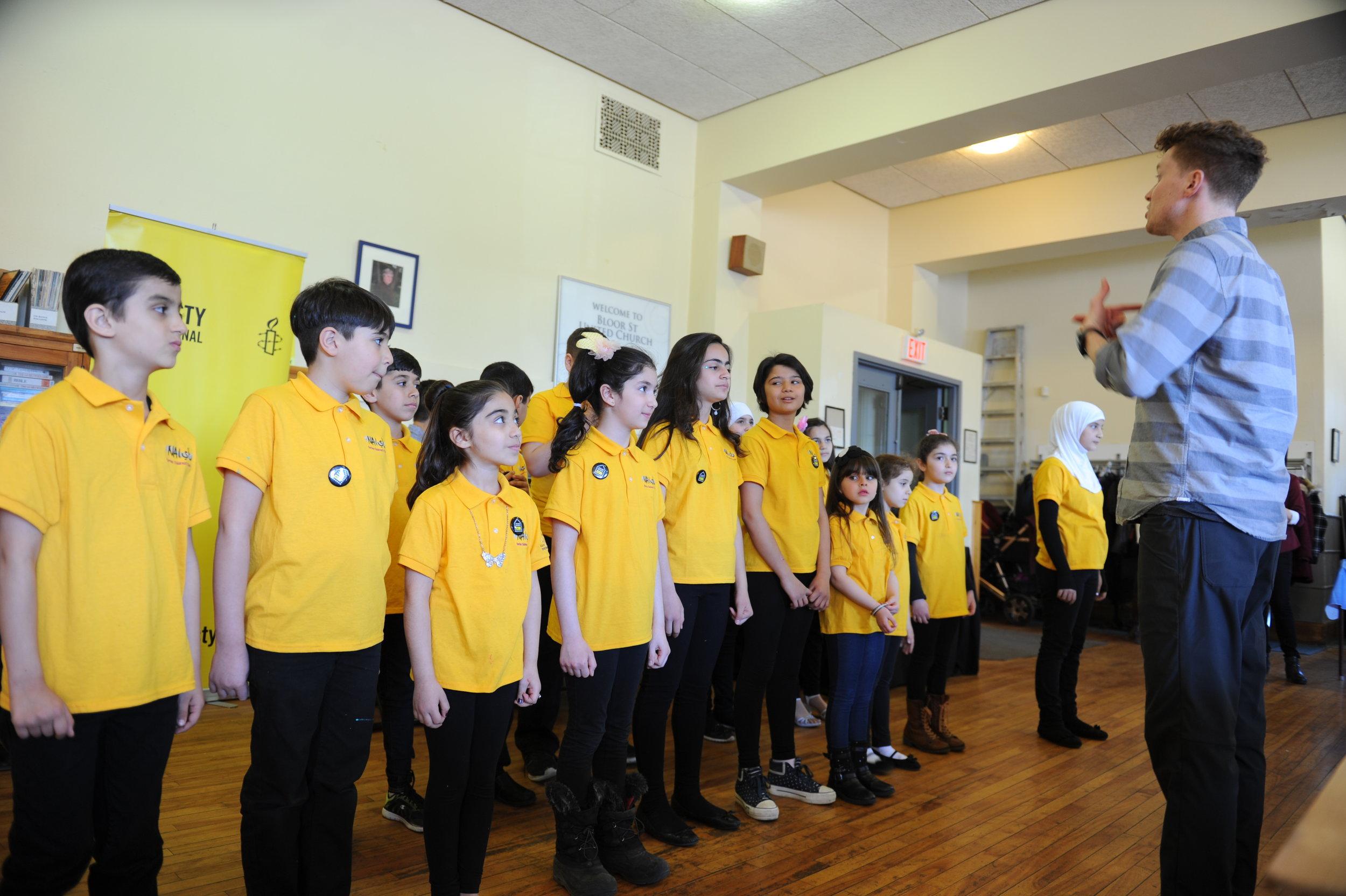 RPSM teacher Lucas directed the choir at the Refugee Day Concert 2017