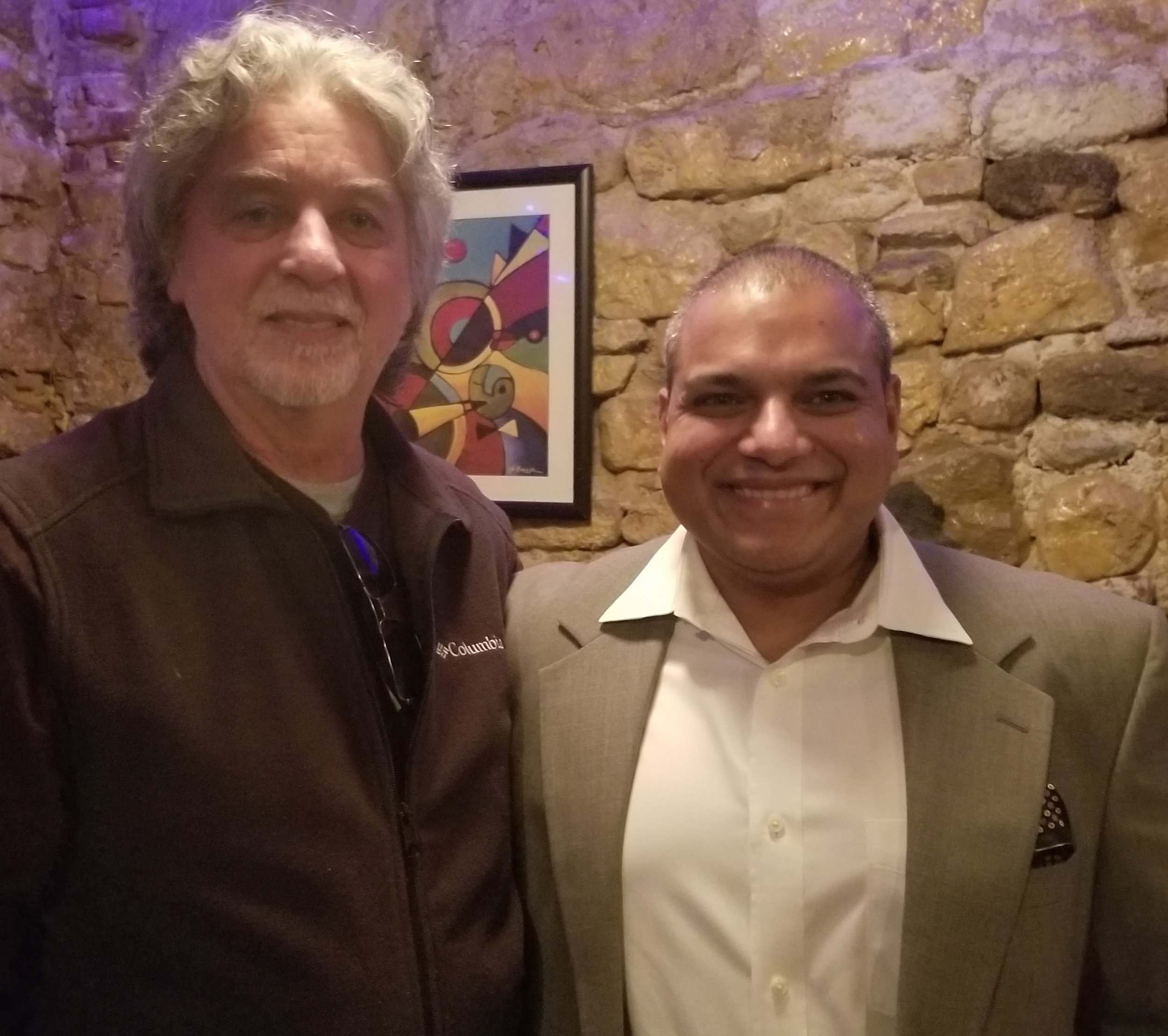 Yogesh and dean celebrate together at a holiday party