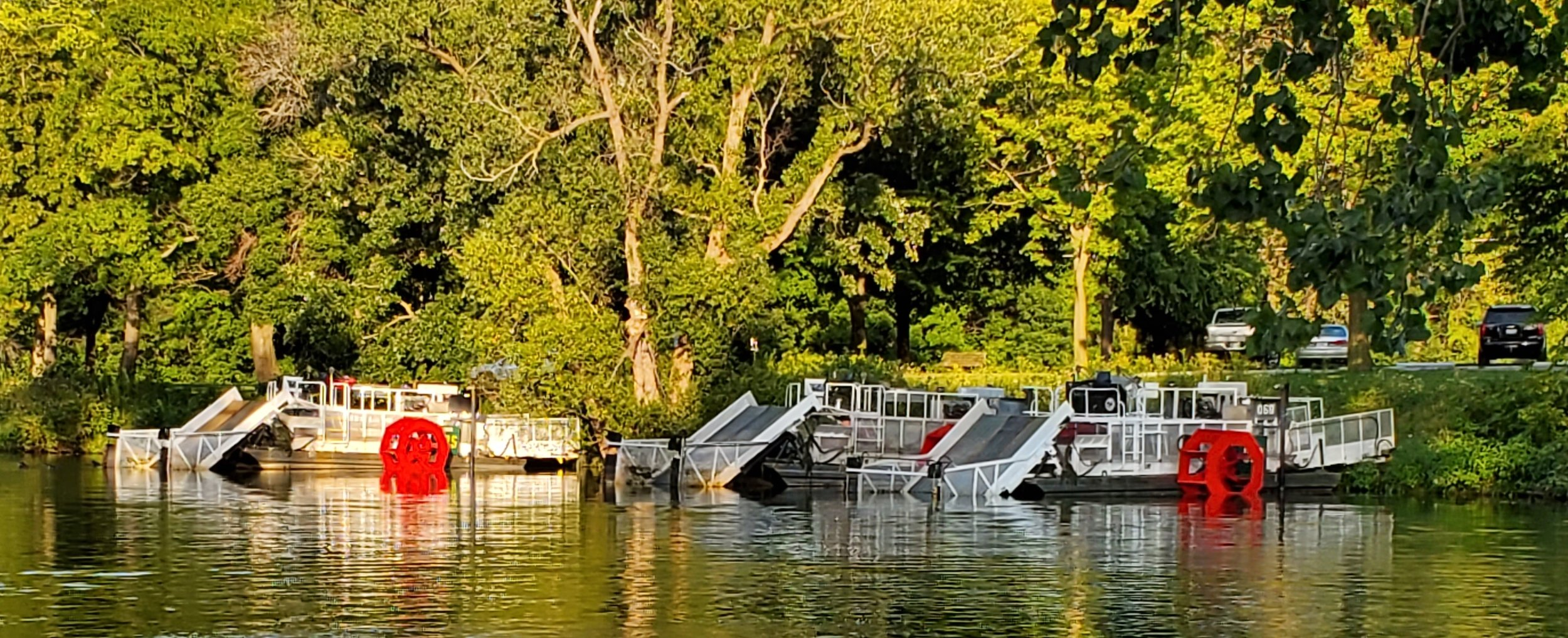 Aquatic plant harvesters parked on Lake Waubesa