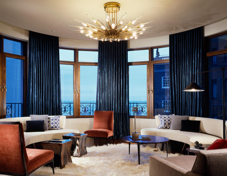 custom curved lounge sofas & decorative throw pillows  Interior Design: Leslie Jones & Associates