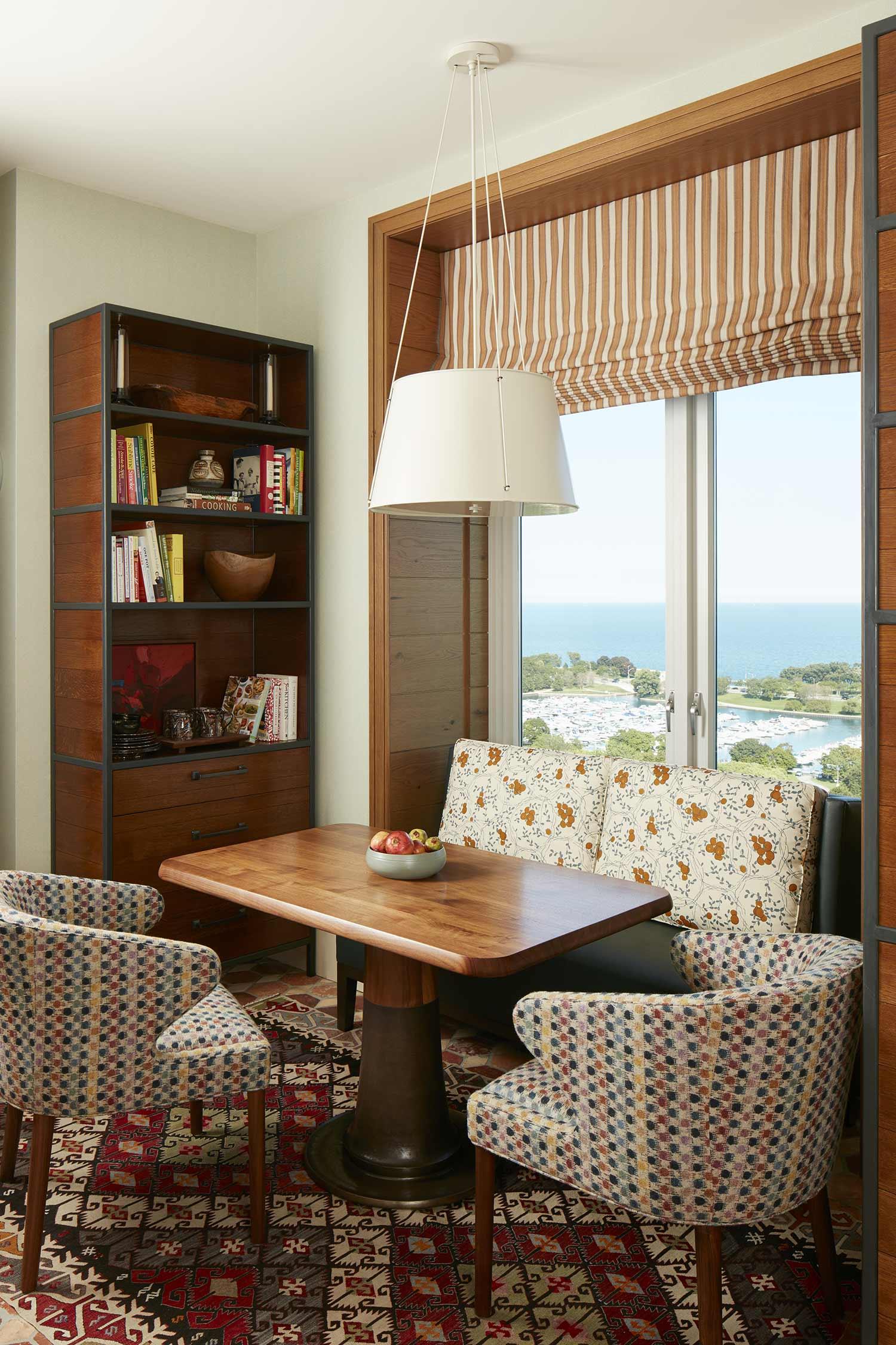 custom banquette & flat roman shade Interior Design: Bruce Fox, Inc.
