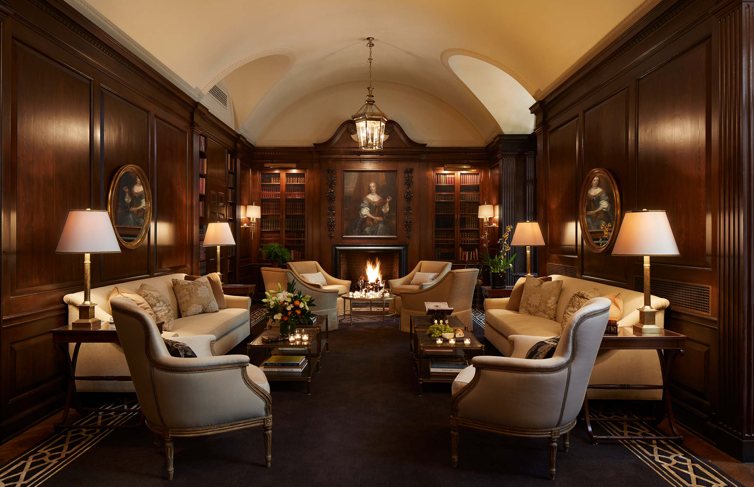 custom sofas, custom skirted lounge chairs, reupholstered bergere arm chairs & decorative throw pillows  Interior Design: Craig & Company for Women's Athletic Club, Chicago