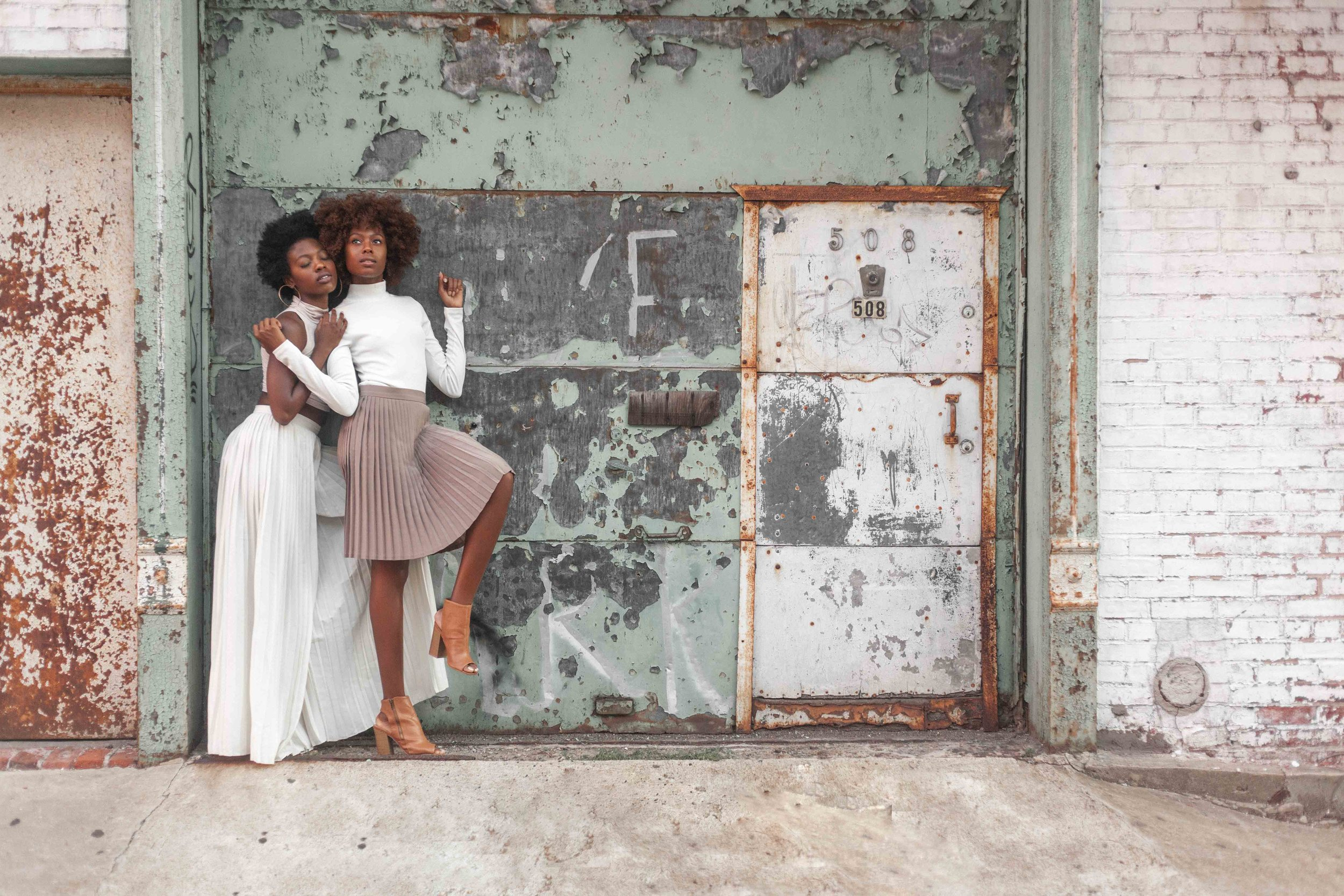 Outdoor Portrait Photography with two black models captured by Jarrod Anderson