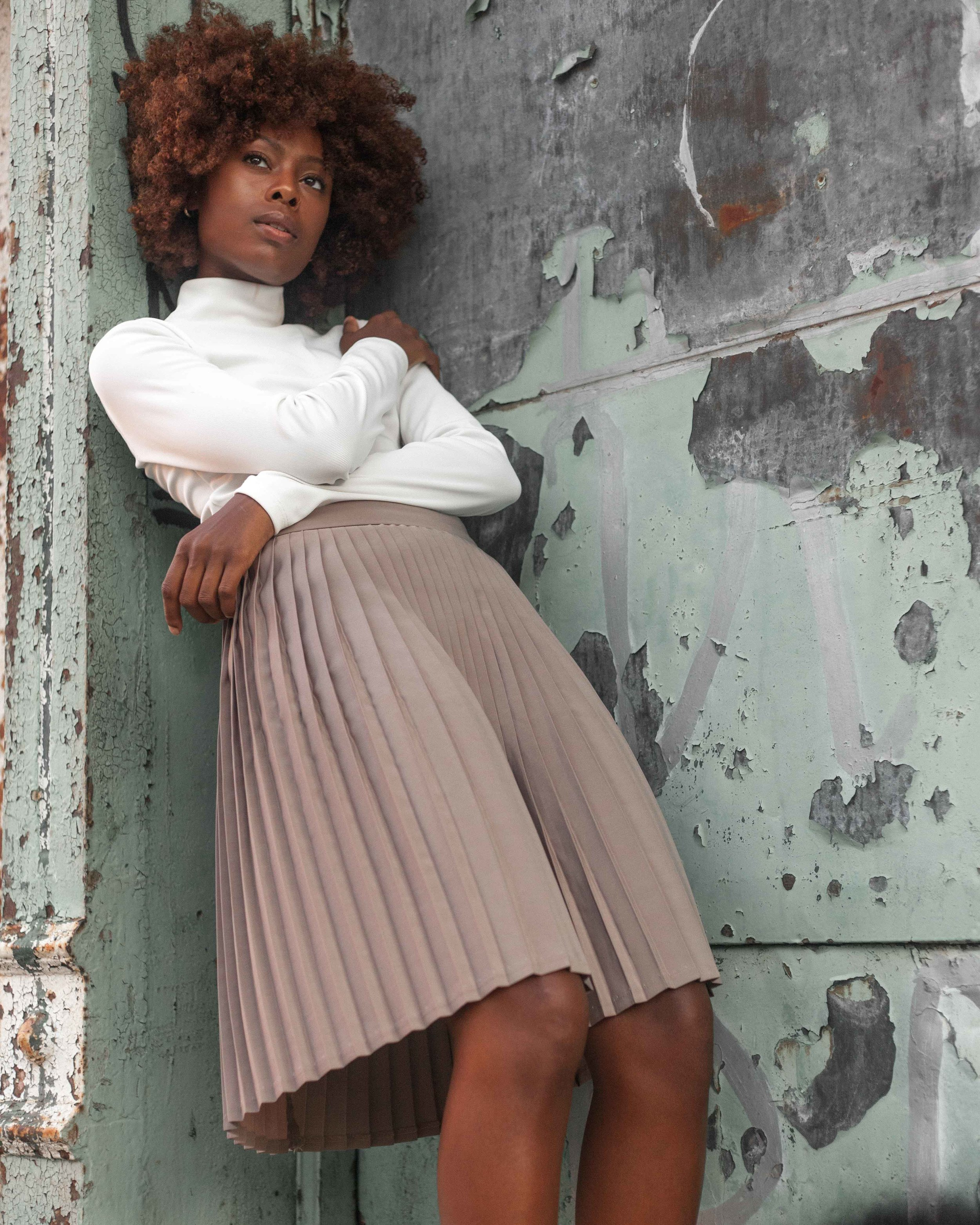 Model standing with wall Digital Portrait Photography captured by Jarrod Anderson