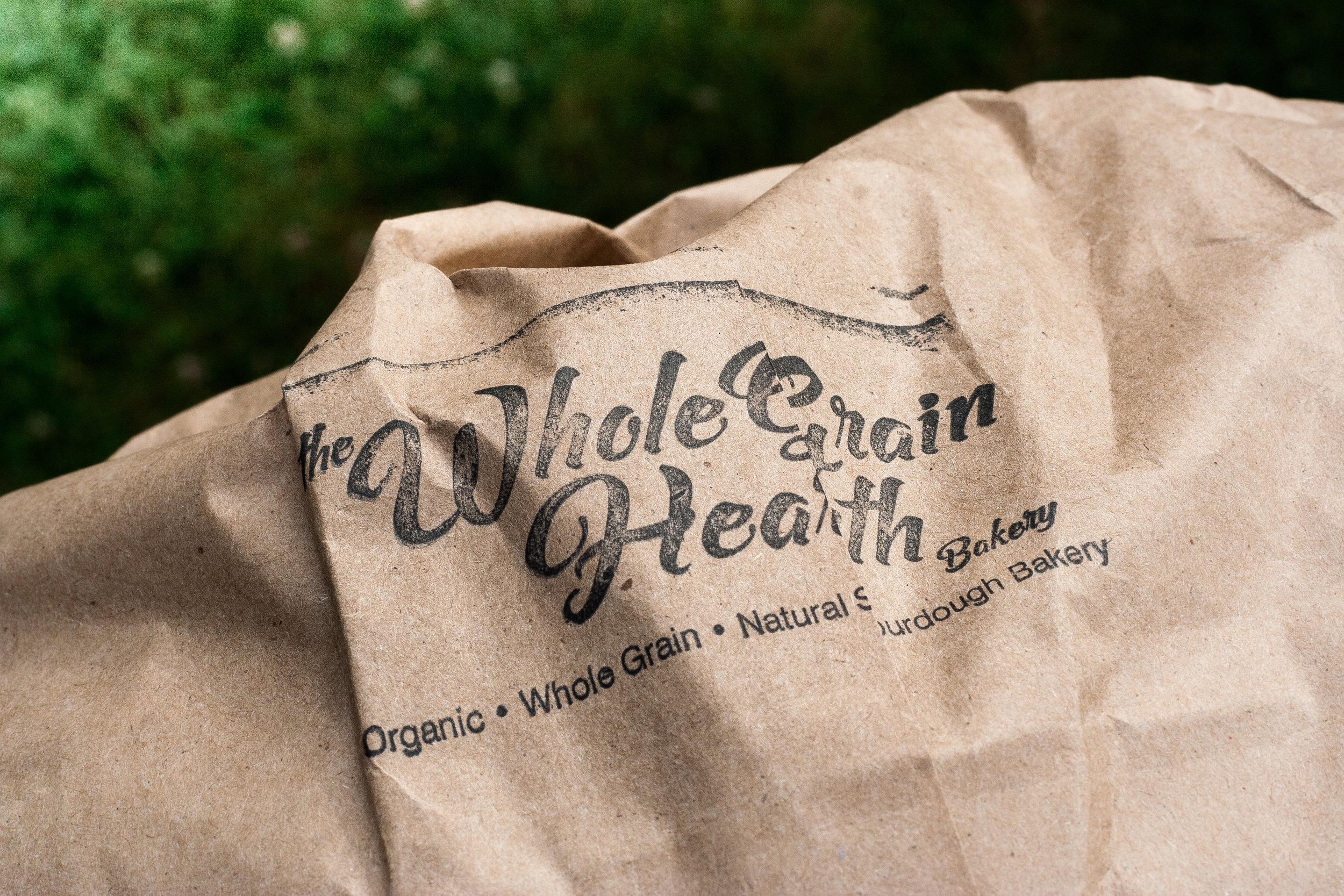 The Whole Grain Hearth Bakery logo