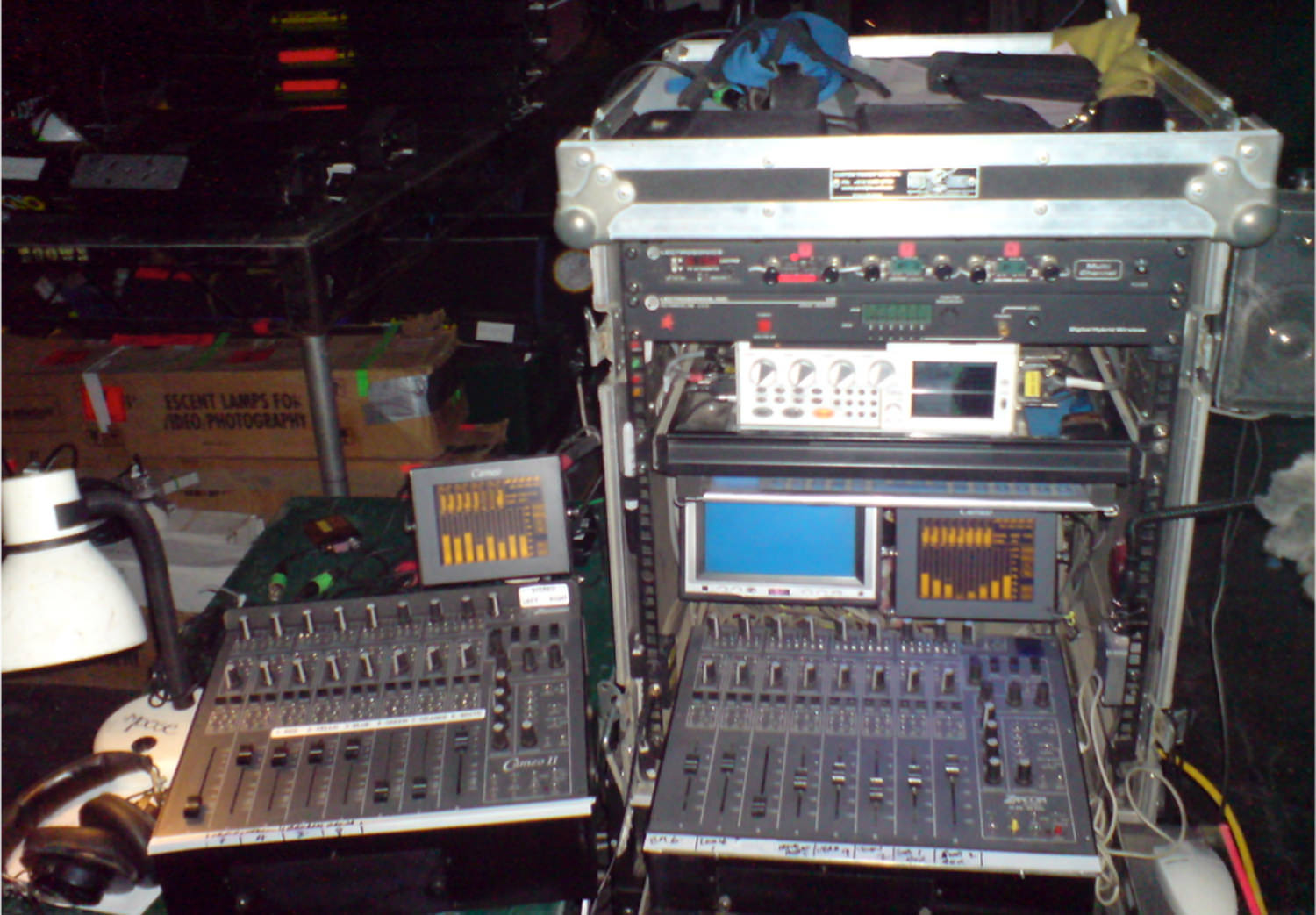 My digital recoding set up for the last day on The Pacific 2010 after 10 months. Using two Zaxcom Cameo 8 track digital mixers. I was mixing 14 microphones down to an 8 track Zaxcom Deva 4 Hard Disk recorder. Above is a rack of 12 wireless microphones feeding into the mixers. The blue screen is a video monitor from the main movie cameraso I could follow the action. I built all my own carts as they suited my style of work better than manufactured ones and could be adapted to the requirements of each different job.These two $25,000 mixers became obsolete after this job and had to be replaced with a newer one.