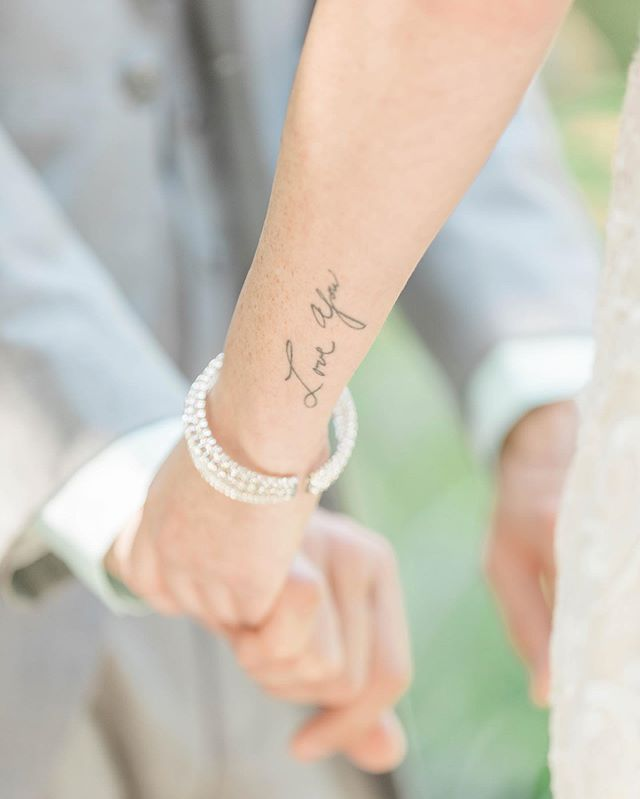 """Love you""... #philadelphiaweddingphotographer #newjerseyweddingphotographer #wedding #phillyinlove #bride #tattoo #bridetattoo #weddingphotography #weddingdetails #details #tinytattoos #theestateateaglelake #eaglelakewedding #newjerseywedding #contemporaryweddingsmagazine"