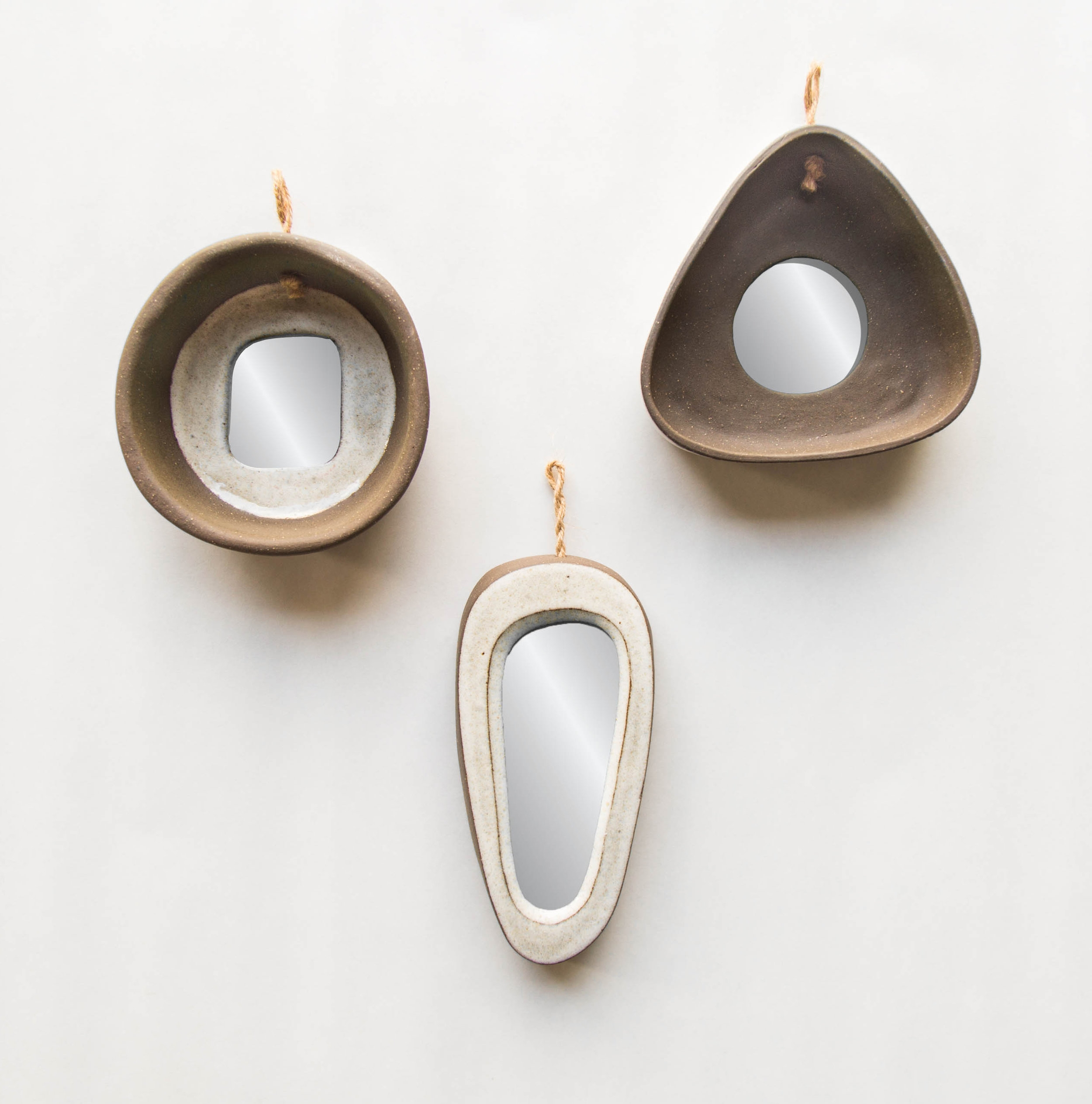 brown stoneware  white glaze/unglazed hangs with jute rope