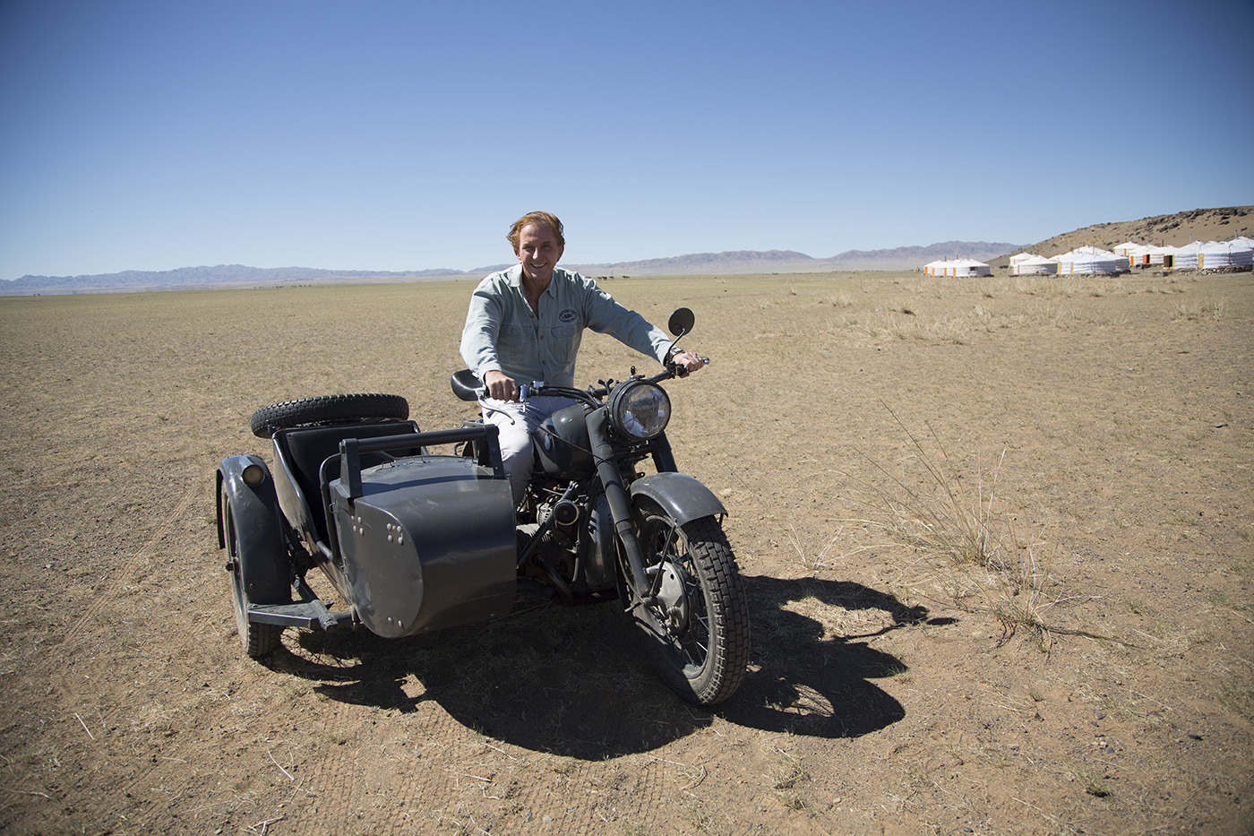 Geoffery Kent poses on bike in the desert